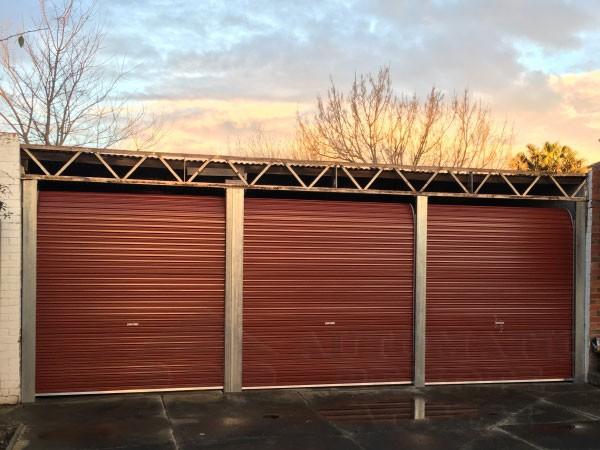 3 x A series manor red roller garage doors